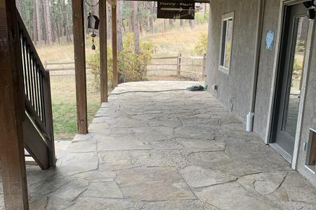 Flagstone patio in the back of a home in Perry Park Colorado