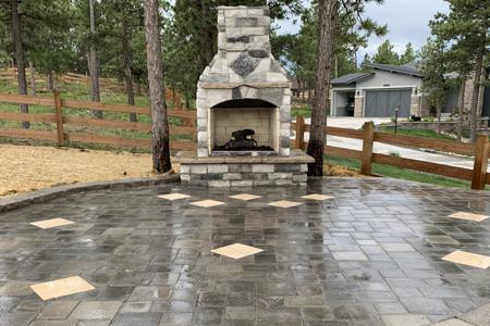 Paver patio, veneer stoned fireplace for a gas insert in Monument Colorado